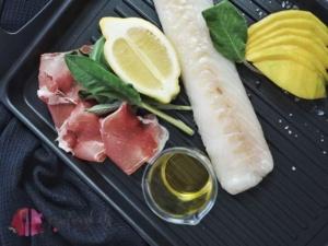kabeljau als saltimbocca mit Mango, Salbei und Rohschinken auf dem Grill zubereitet.